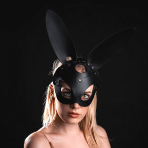 Young lady in black leather Bunny mask