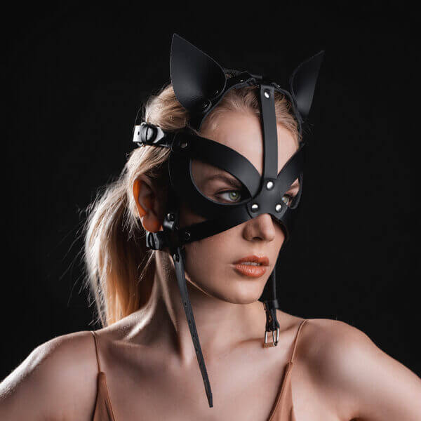 Young lady with black leather Harness Kitty mask